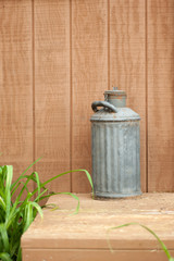 antique milk can on porch