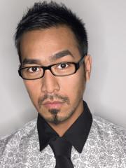 Man Wearing Glasses in studio, portrait, head and shoulders