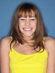 Girl in studio smiling, head and shoulders