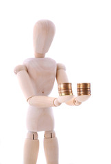 wooden figure holds coins