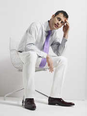 Anxious Businessman Sitting in Swivel Chair