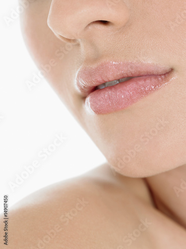 Young Woman Wearing Pink Lipstick, close up of mouth