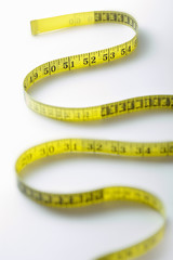Winding strip of measuring tape, close-up