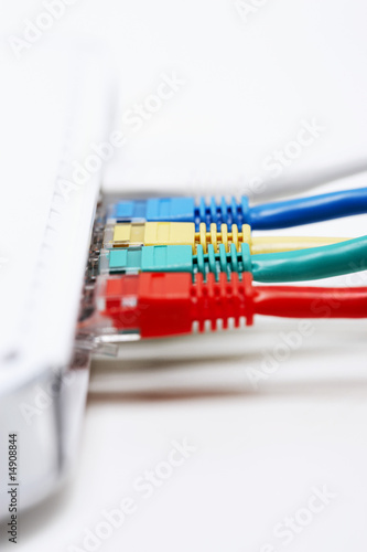 Colourful row of network connection plugs
