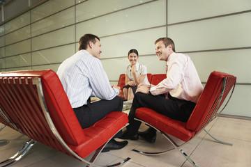 Smiling Businesspeople Having Meeting in office