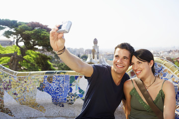 Smiling couple taking photo of themselves, portrait