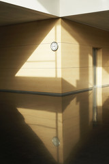 Empty corridor with clock on wall