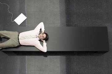 Businessman Lying down on Bench, view from above
