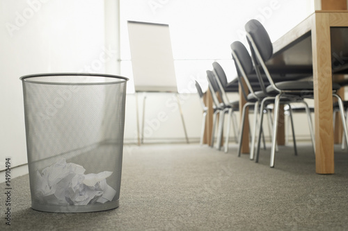 Trash Can in Empty Meeting Room