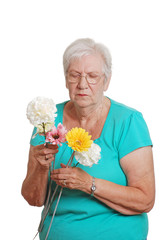 Senior woman sorting a bunch of fake flowers