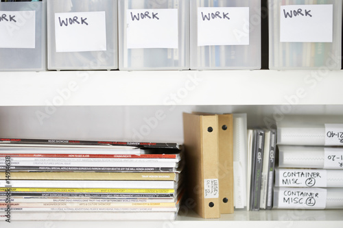 Magazines and folders in organized shelves