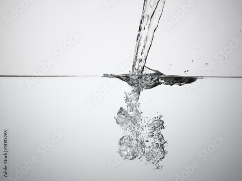Jet splashing into water, surface view
