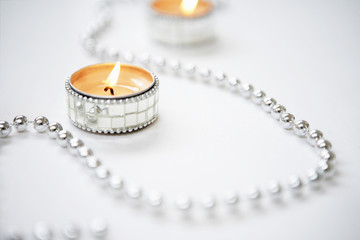 Tea light Candles and Silver Garland, close up