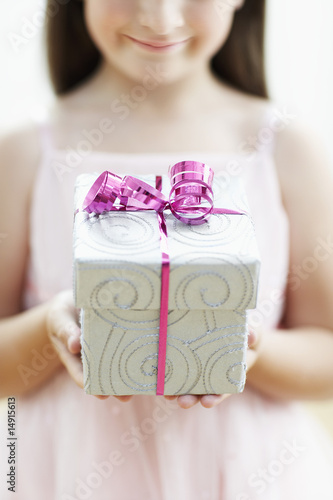 Smiling Girl with Gift, mid section, close up