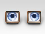 Two television sets with eyes on screens, digital composite