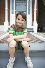 Boy With Bandaid on Knee