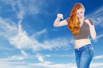young girl with red hair fighting