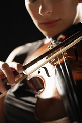 Woman Playing Violin, close-up