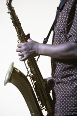 Saxophonist, mid section, side view