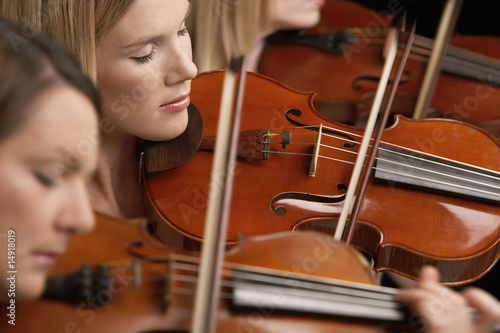 Women Playing Violins in musical group, close-up