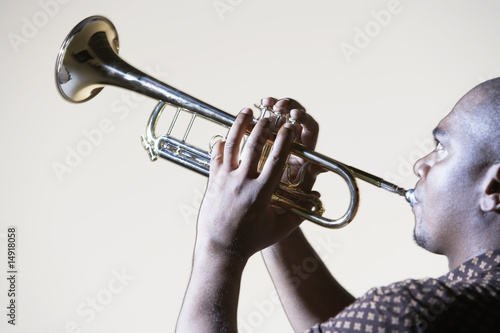 Trumpeter playing, looking up, close-up, side view