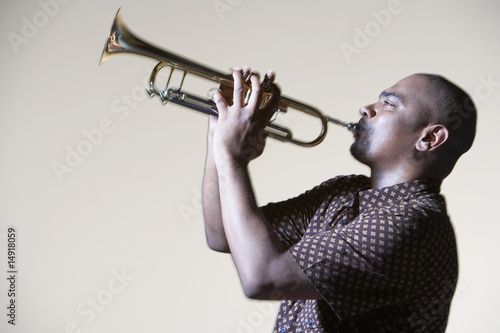 Man Playing Trumpet, close-up, side view