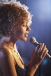 Jazz singer on stage, profile