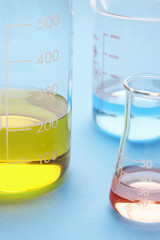 Coloured liquids in beakers, close-up