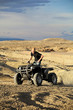 quad in hills - teen on four wheeler ATV
