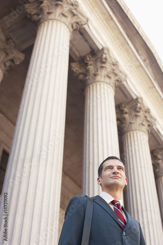 Lawyer outside courthouse, low angle view