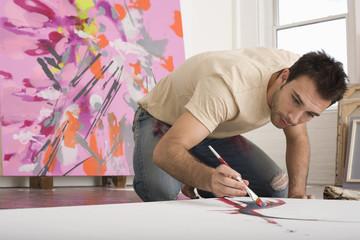 Artist Working on Canvas on Floor of Studio