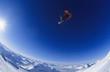 Skier jumping, against blue sky