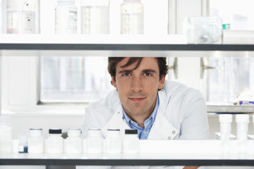 Lab Worker Looking Through Shelves