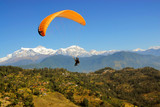 paragliding with himalaya view in nepal poster