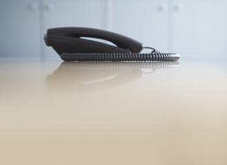 Telephone on desk, side view