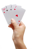 Player's hand revealing Four Aces poster