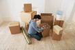 Woman Looking at Contents of Moving Boxes