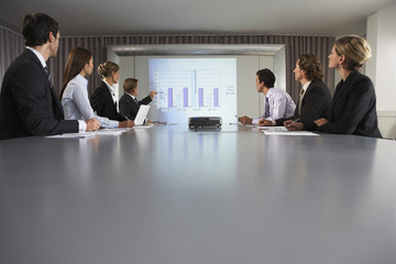 Businessman Giving Presentation in Conference Room