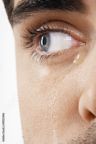 Man's eye, crying