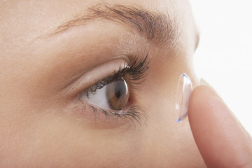 Young Woman Putting in Contact Lens