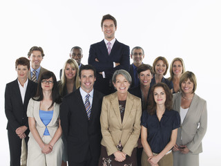 Group of smiling businesspeople, man standing taller