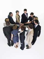 Group of Businesspeople in a circle, joining hands