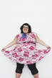 Overweight woman curtseying, portrait