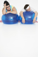 Overweight Man and Woman with Exercise Balls