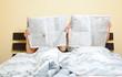 Leinwanddruck Bild - couple newspaper in bed