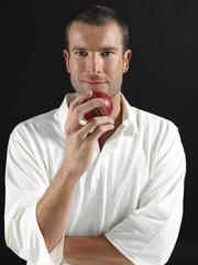 Man holding cricket ball, portrait