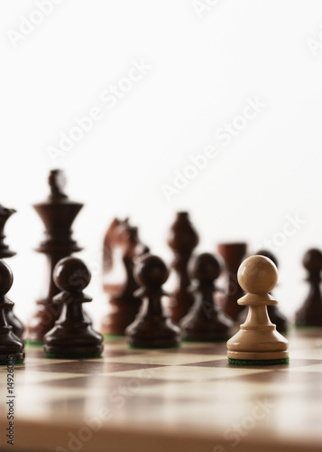 Chess game, one white piece in front of black pieces
