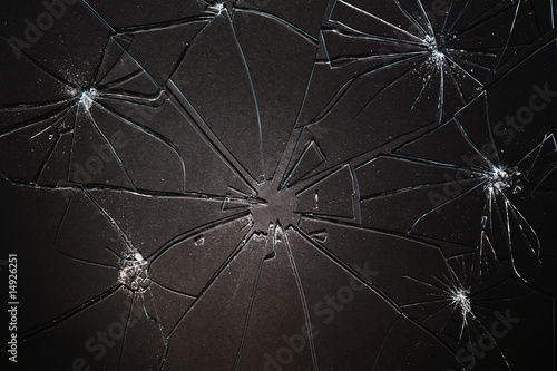 Broken glass pieced together on black background