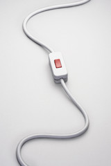 Switch on power cord, against white background in studio