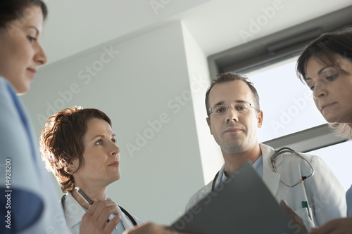 Physicians Reviewing Medical Chart, low angle view